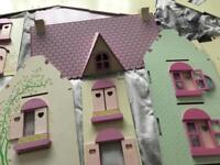 Girls wooden dolls house