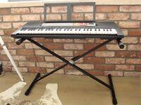 YAMAHA PSR-F50 Keyboard with adaptor plus Tiger Stand