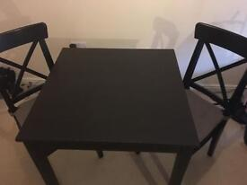 Black tv unit coffee table and dining table with chairs
