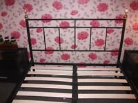 DOUBLE BLACK BED FRAME AND 2 BLACK 1 DRAWER GLASS TOP BEDSIDE TABLES.