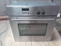 built in neff oven with stainless steel cooker hood