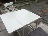 IKEA dining table and two solid wood chairs