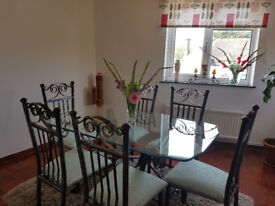 Dining Room Suite, Lovely condition. Glass bevelled table with pewter legs and base, Six chairs