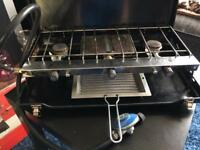 Camping cooker with grill