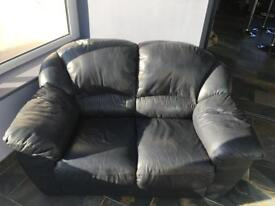 Airforce blue leather sofa
