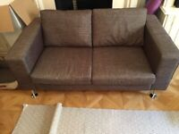 Designer Sofa and Armchair for sale (like new) at bargain price! Must go! Can be sold separately.