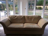 Cream coloured 3 seater sofa