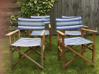 Four stripped directors deck chairs