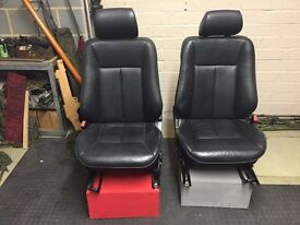 ex-jaguar fully adjustable car seats on wooden stools that can be used for various purposes