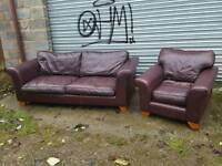 Cute cherry brown leather sofa suite .large 3 seater and 1 armchair .can deliver