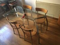 High quality John Lewis glass dinning room table and four chairs. Only £150.00