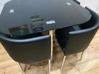 Algarve black glass stowaway dining table + stools