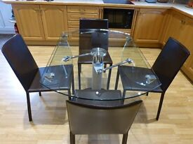 Glass Dinning Table 10mm And 4 Leather Chairs extenable from oblong to round.