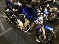 Blue Suzuki bandit 650, 2007, 26k miles.