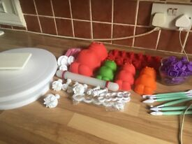 There is a jelly baby family cake moulds and other cutting tools