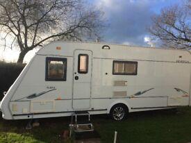 Compass Omega 540,2005. 4 Berth. Fixed double bed caravan.
