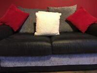 Two seater sofa bed black and grey for sale