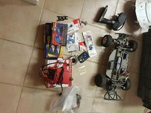 Traxxas rc car with upgraded motor and suspension parts