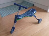 Scuttlebug, blue dragonfly design, by Mookie. Toddlers fold away trike.