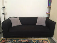 IKEA KLIPPAN TWO-SEAT SOFA, Granån black - £80 (pillows included), Need to sell fast!!