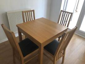 Oak table and chairs from Debenhams