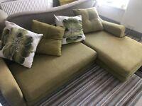 Green sofa and armchair