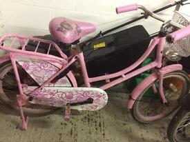 Pink girls Dutch bike