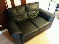 2 seater sofa black leather effect in good condition from Argos