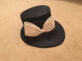 Stunning hat. Navy Blue with ivory satin bow. Worn once. Perfect for any occasion. Paid £125 new