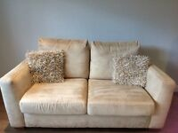 DFS TWO SEATER CREAM SOFA