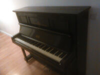 Lovely upright wooden piano (Berry of London). £50 ono