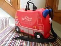 Trunki - Frank The Fire Truck (Red). Childs ride-on hand-luggage. Excellent Condition, used once.