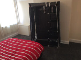 Buildable portable wardrobe made from plastic, used temporarily