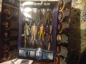 11 figure dr who set in yard is box