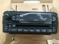 NEW GENUINE CHRYSLER JEEP DODGE 05-11 RADIO / CD PLAYER 05091610AB