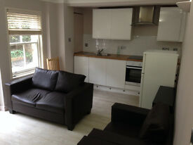 A lovely furnished 2 bedroom flat with own outside patio area.