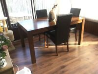 Dining table 150cms x 90cms with four chairs. Good condition but one chair seat needs recovering