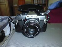 Olympus OM20 SLR camera with 50mm lens and camera case