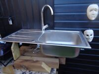 Stainless steel sink with mixer taps