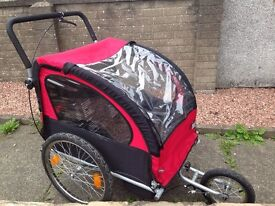 Buggy,DOUBLE BIKE TRAILER, JOGGER 2-IN-1 for 1 or 2 children , foldable(German brand)
