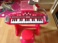 ELC pink keyboard/piano with stool
