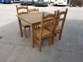 Wooden table and four chairs