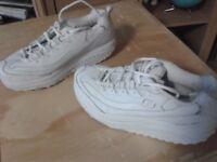 Ladies white Skechers for sale.