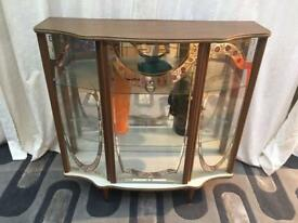 Retro glass mirrored display cabinet with shelves. Freestanding on tapered legs.