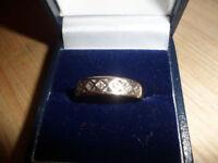 9ct diamond half eternity ring .