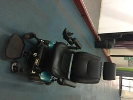 P320 Electric Powered Wheelchair. VGC with new batteries and charger included. local delivery poss.