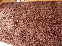 Large dark brown contemporary rug.
