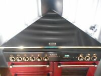 dual fuel RANGEMASTER 110 range cooker in cranberry with hood.
