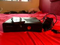 Xbox 360, charger and 3 games £30