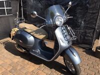 Vespa GTS 300 i.e. Excellent condition. Metallic Grey. Front and rear touring racks and screen.